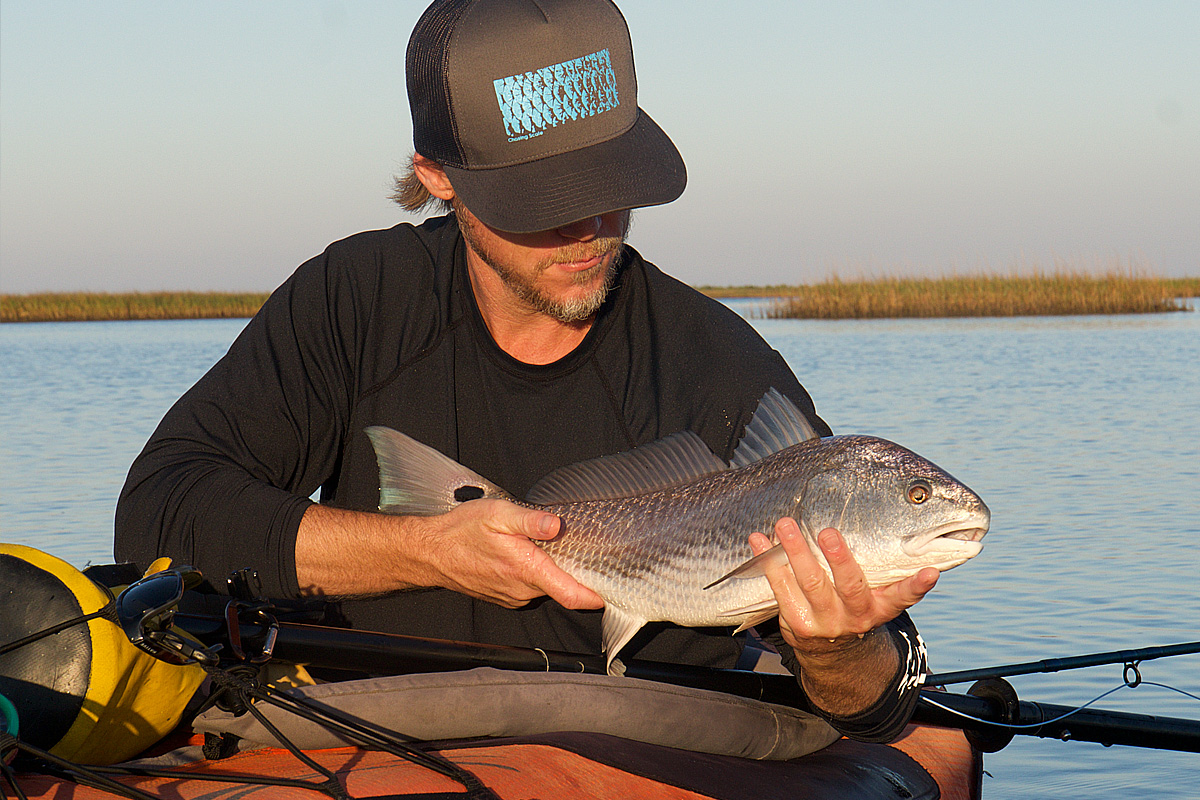 Kayak fly fishing louisiana redfish adventure travel bayou for Louisiana redfish fly fishing